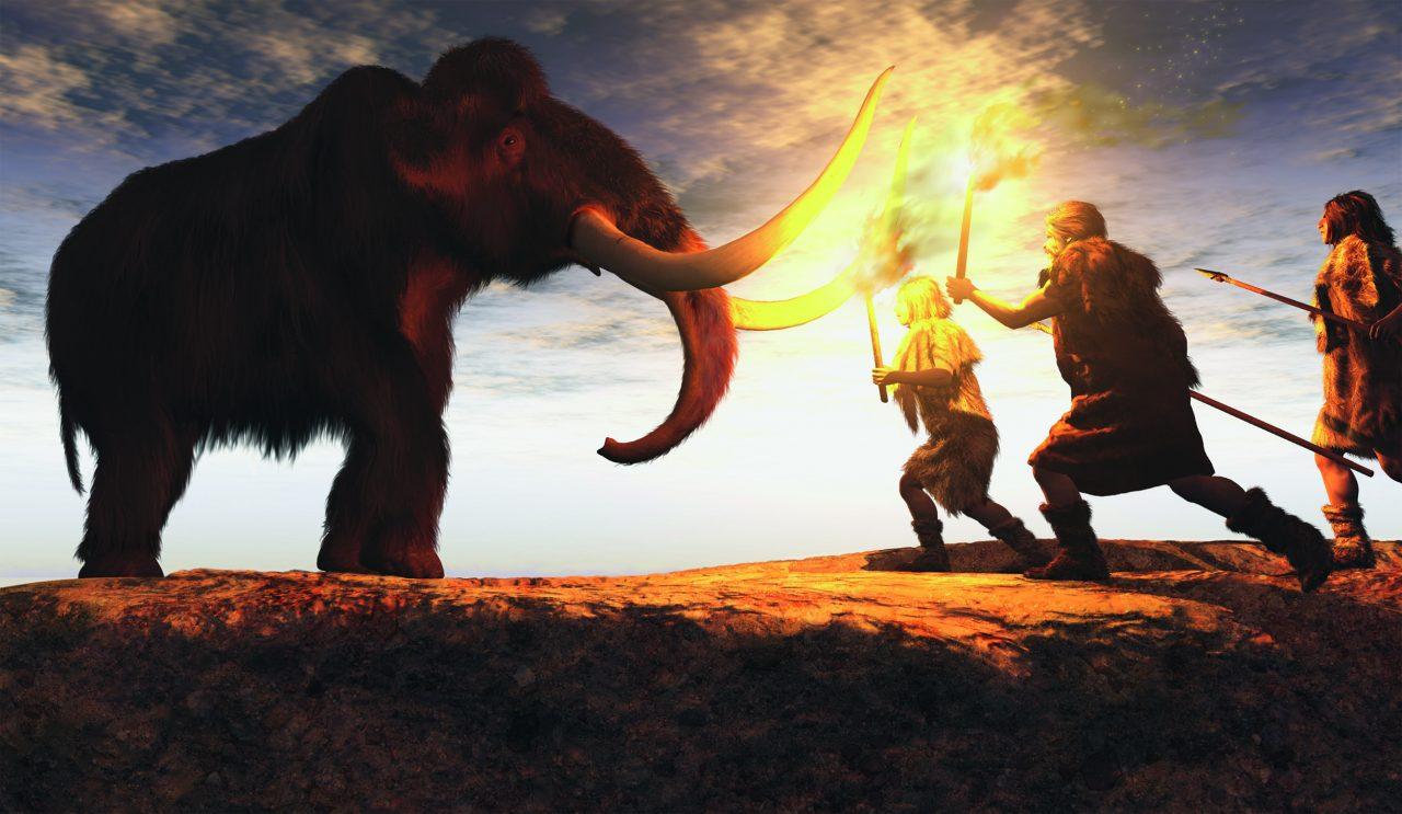Jegere med flammer i et møte med en mammut
